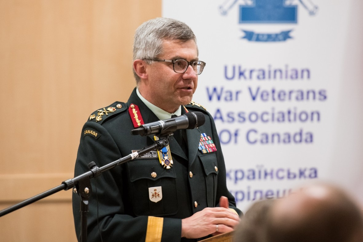 LGen Paul Wynnyk CMM MSM CD presenting to a packed house and wearing his Knight's Cross. Photo by Stephen Parry.